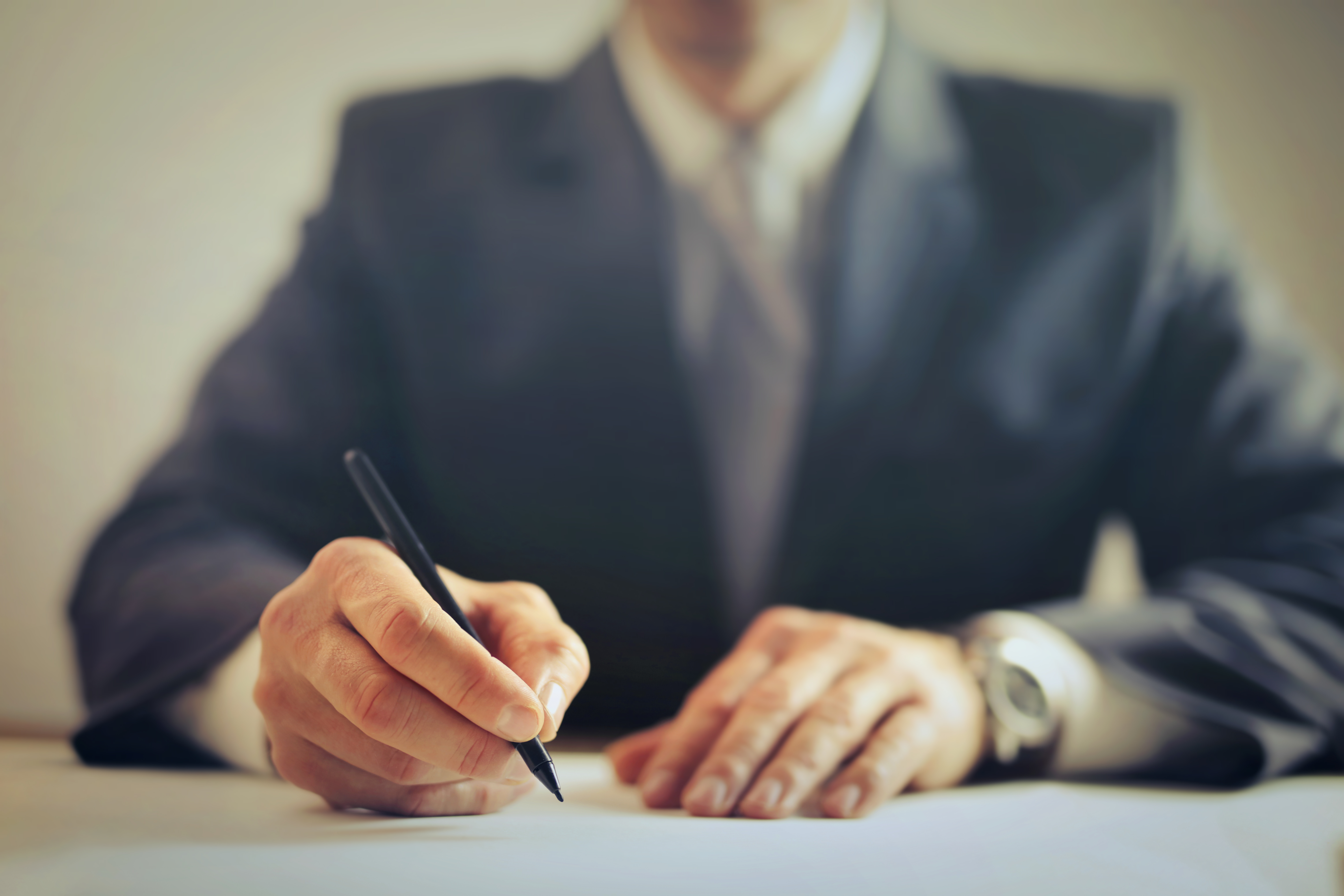 crop-businessman-signing-contract-in-office-3771097.jpg